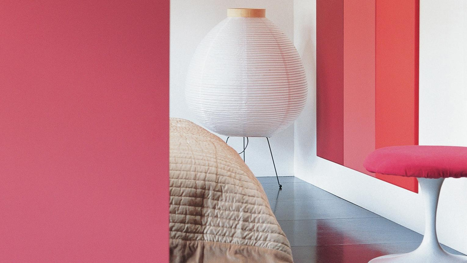 A spectrum of red shades brings an upbeat mood to the bedroom.