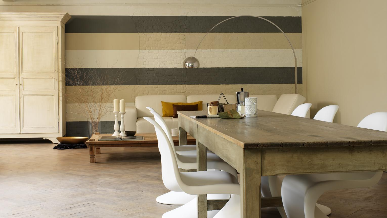 A wall of wide stripes in warm, neutral shades draws the eye.