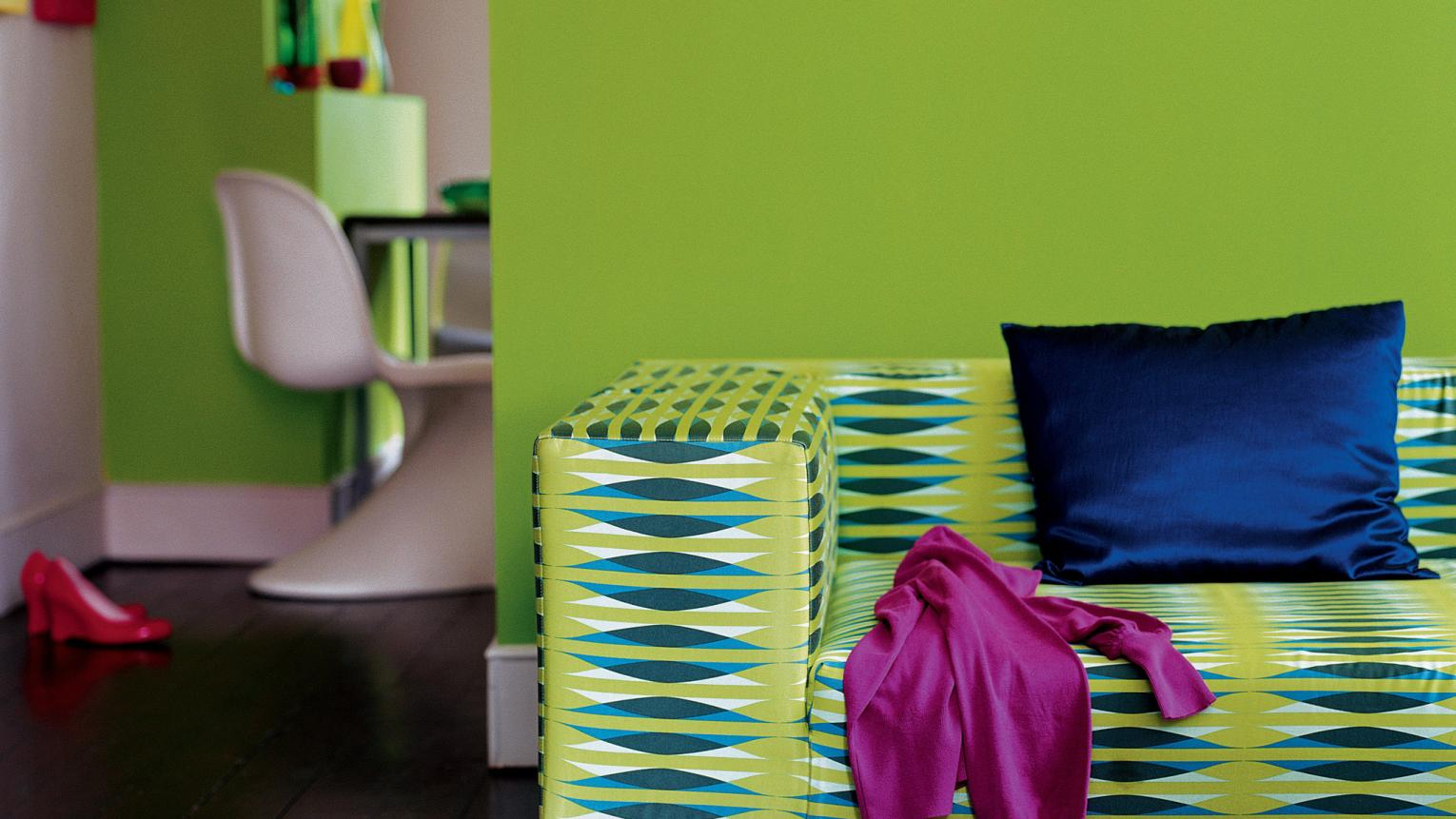Pair a striking lime green wall with dramatic dark wood floors.