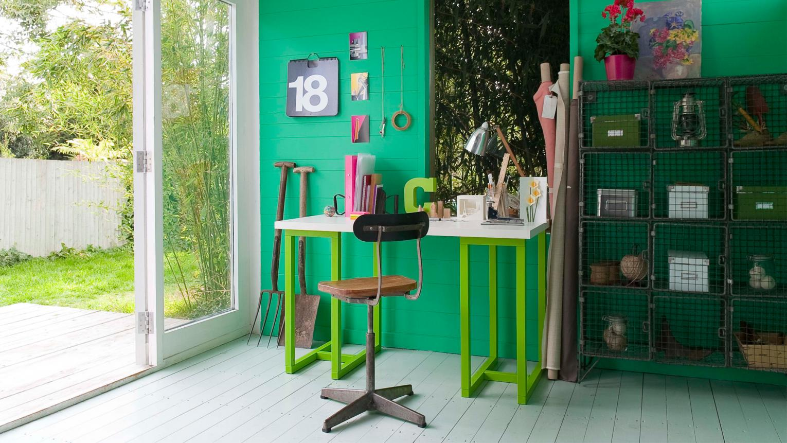 Punchy emerald green contrasts with vintage office furniture.
