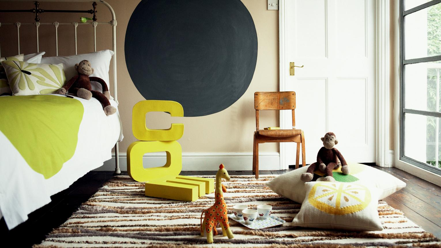Create a calm kids' room with warm neutrals and bright touches.