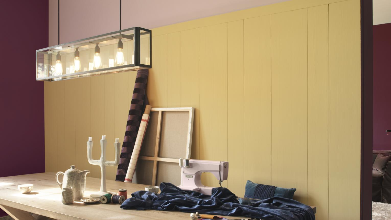 Use rich pinks to add creative passion to a wall of yellow.