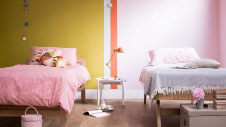 Paint vertical stripes to split a shared bedroom