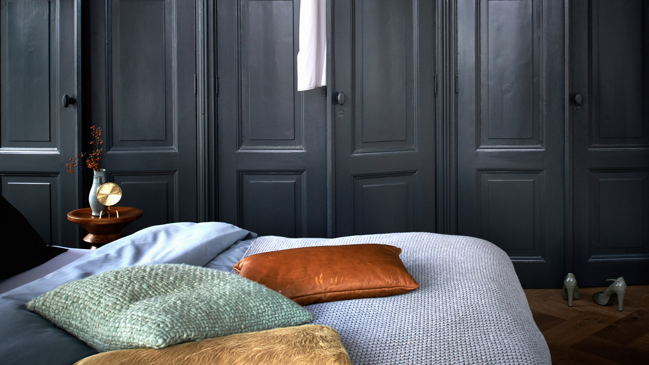 Daring decorators may like to try darker shades of neutrals for a dramatic yet cosy feel in the bedroom.