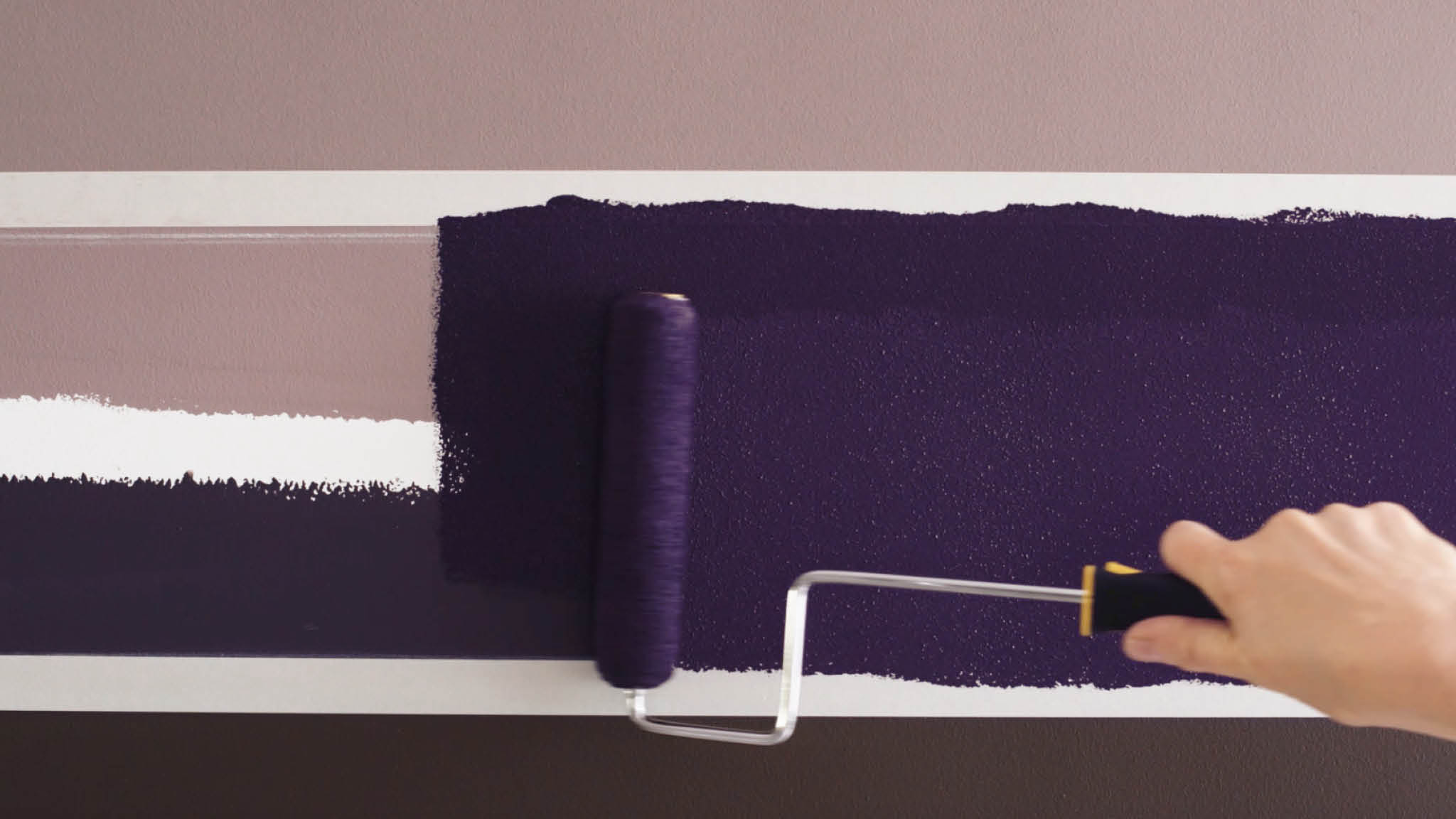 Paint between your taped lines with a small roller