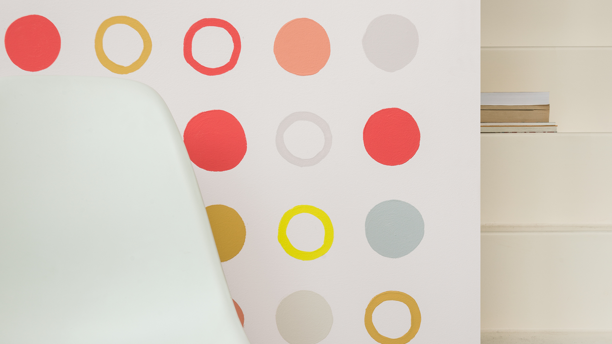 Design a creative and energising breakout space by painting circles in different hues on your wall.